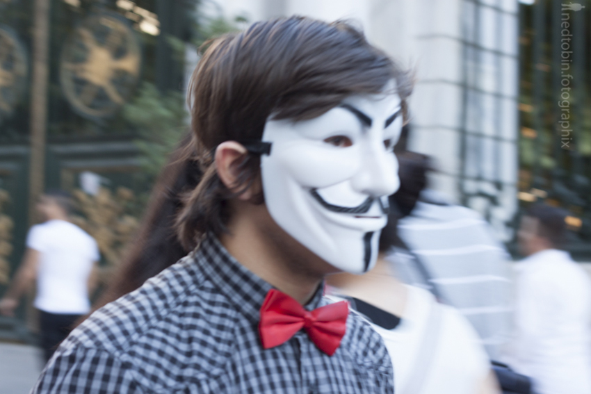 Man with protestor mask and bowtie