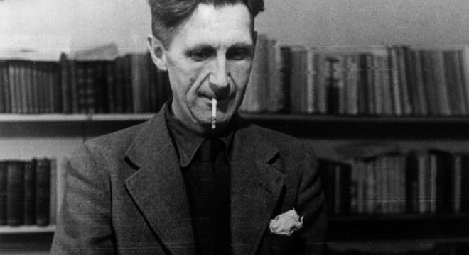George Orwell smoking at a typewriter